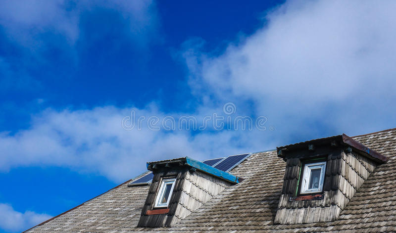 Two windows and garret roof. Of a mountain hut royalty free stock photos