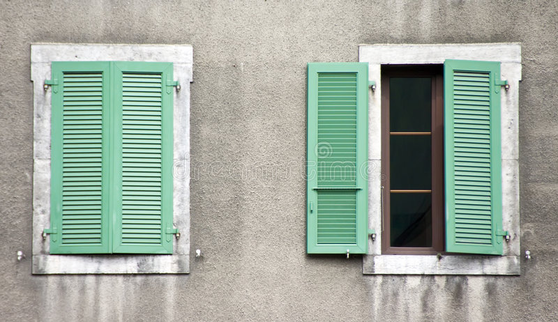 Two windows, green shutters royalty free stock image