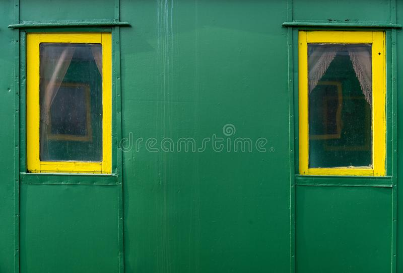 Two windows in an old passenger car. stock photos