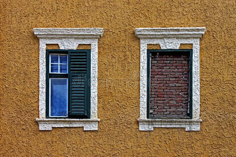 Two windows. One-eyed wall and/or window stock image