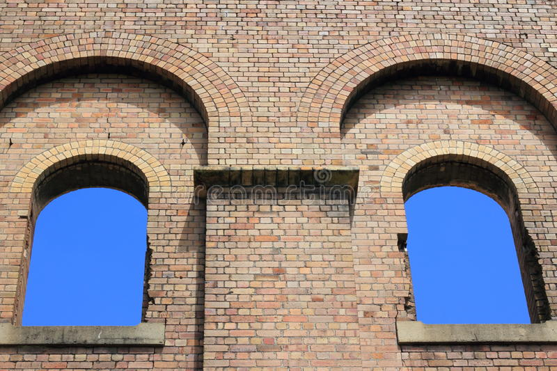 Two windows in ruin towards sky stock images