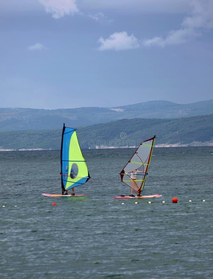 Two windsurfers. (couple) on Adriatic sea royalty free stock photos
