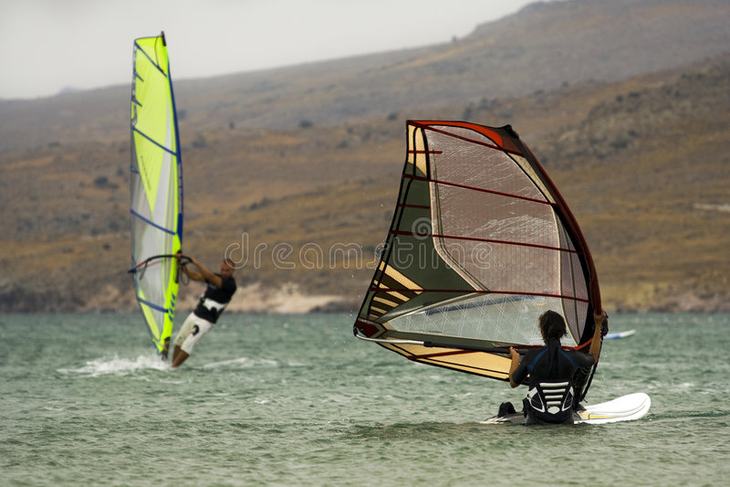 Two windsurfers. Enjoying a windy day in Gokceada, Turkey royalty free stock photos