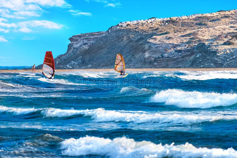 Two windsurfers surfing on Prasonisi beach Rhodes, Greece stock photo