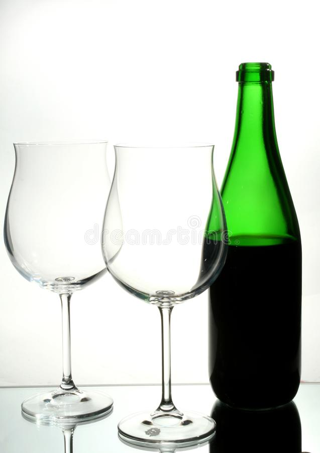 Two wine glasses with red wine royalty free stock photos