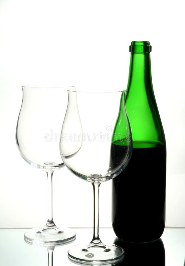 Two wine glasses with red wine royalty free stock images