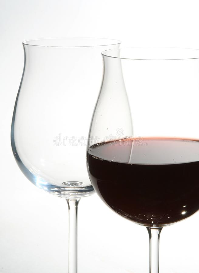 Two wine glasses with red wine stock image