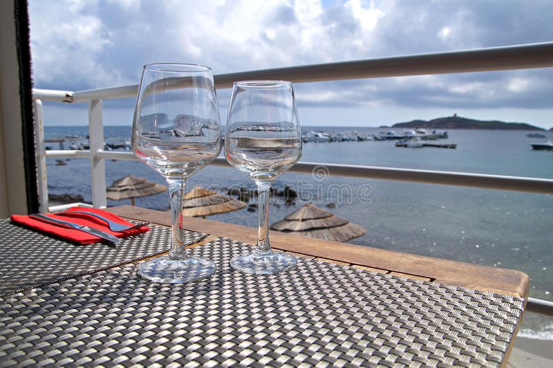Two wine glasses on table at harbor Romantic dinner of Portofino Perfect summer vacation for couples . stock photography