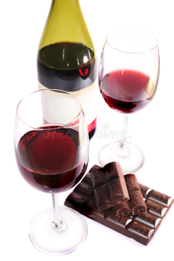 Two wine glasses of wine and chocolate stock images