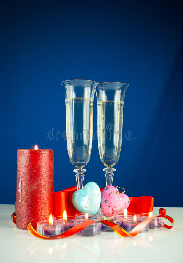 Two wineglasses and burning candles stock photography