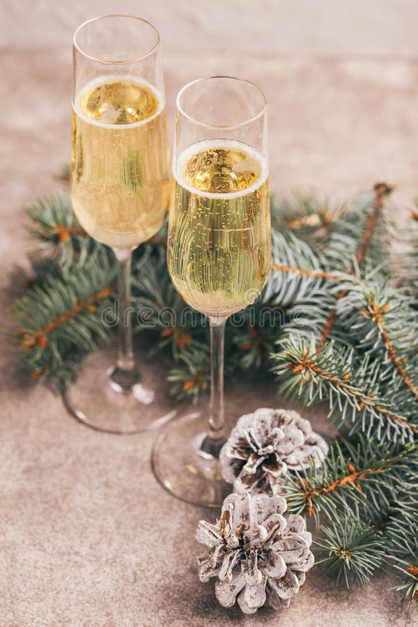 Two wineglasses of champage with Christmas tree branches royalty free stock images