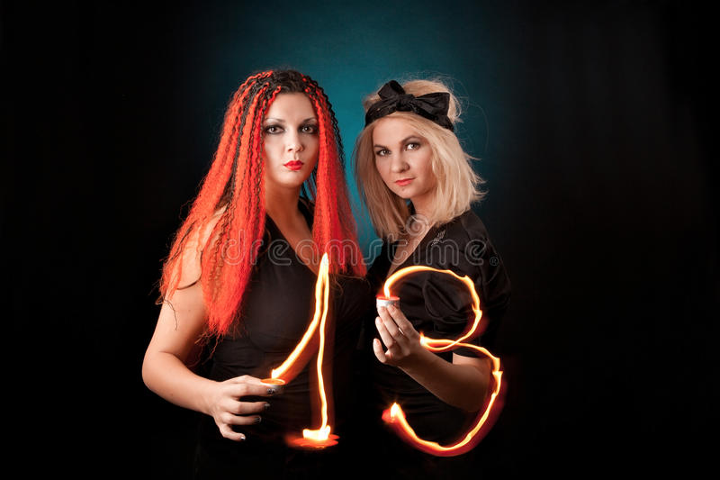 Two witches practises witchcraft. stock image