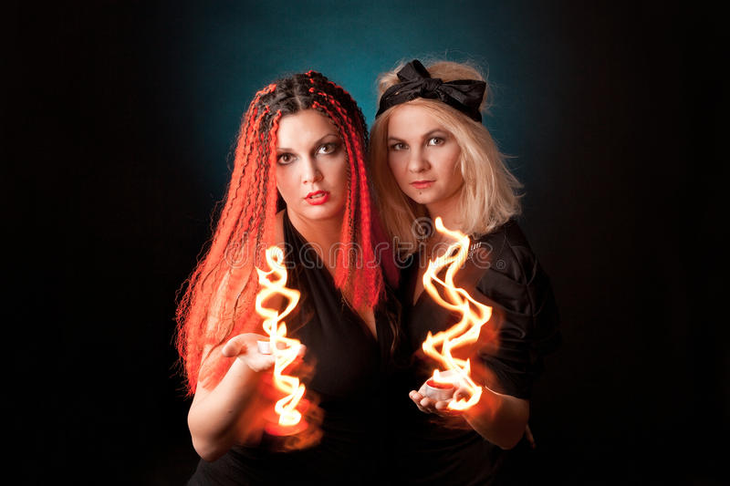 Two witches practises witchcraft. royalty free stock photos