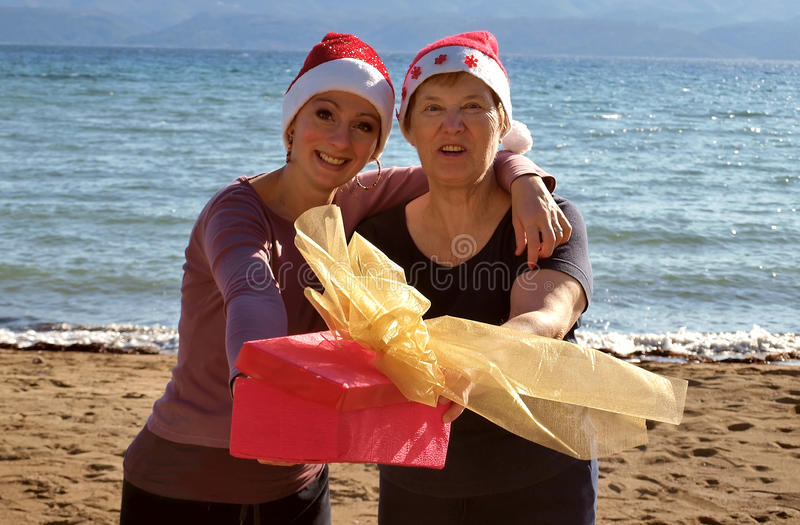 Two woman with a Christmas gift royalty free stock images