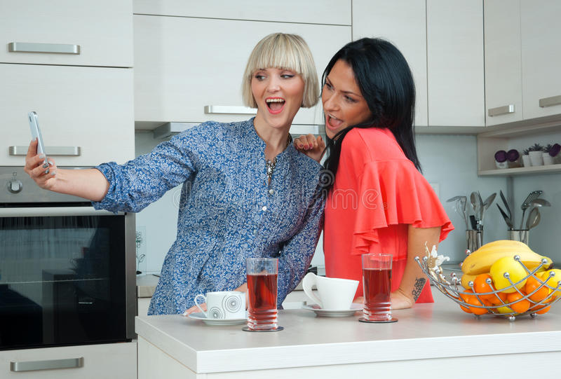 Two woman friends making selfie picture stock photo