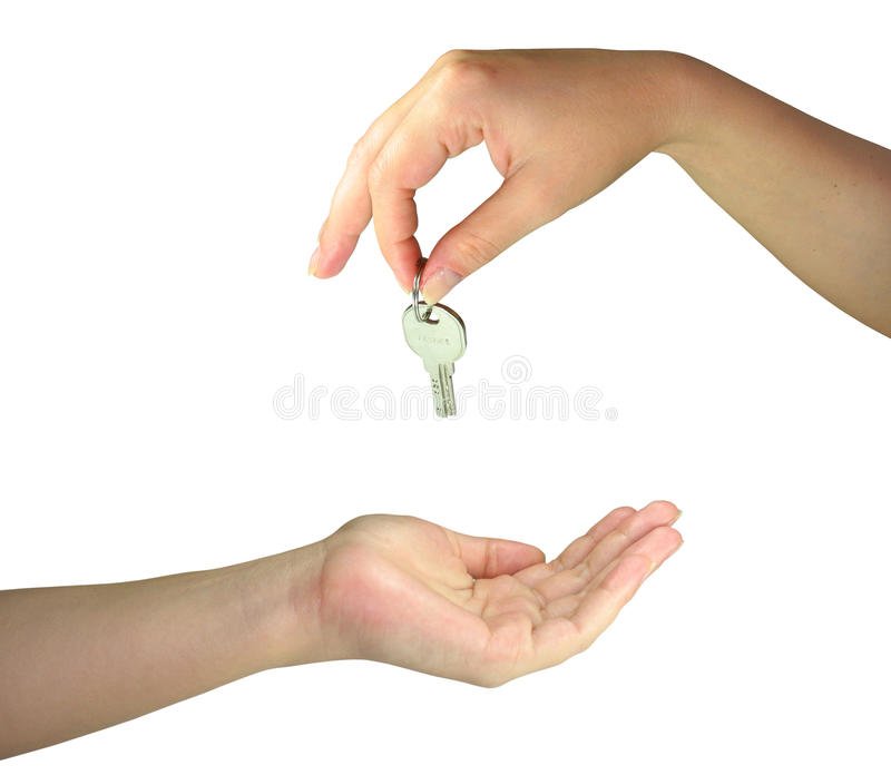 Download Two Woman Hands Giving One Another The Key Stock Photo - Image: 9578070