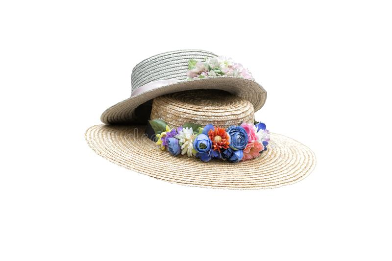 Two woman hats with colorful fabric flowers stock image
