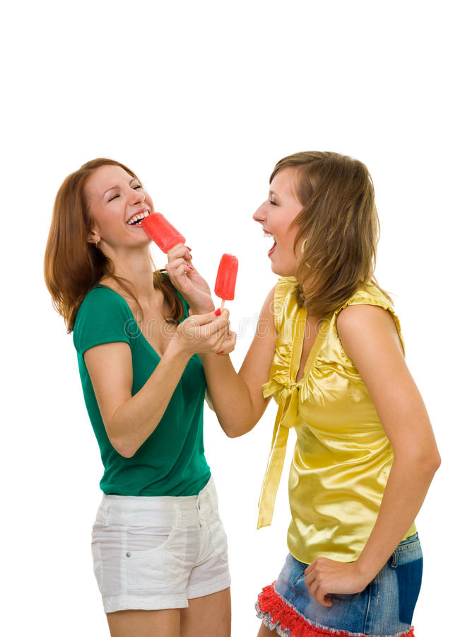 Two woman with ice cream. Two woman eat ice cream and laughing having fun royalty free stock photos