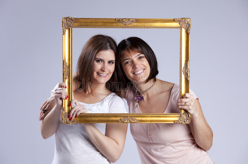 Download Two Woman Inside A Picture Frame Stock Image - Image: 19356057