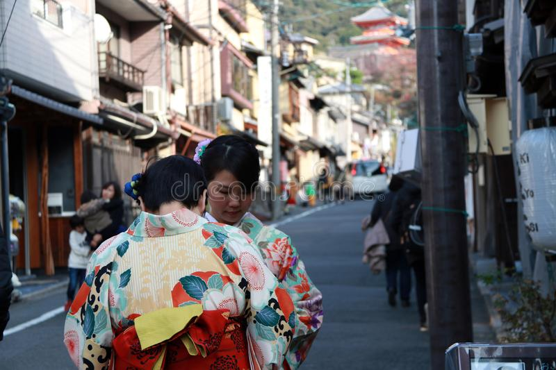 Two woman in Kimono dress on the way to Fushimi Inari Shrine, in Kyoto people will wear national uniforms to worship at temple. Fushimi-ku, Kyoto, Japan royalty free stock photo