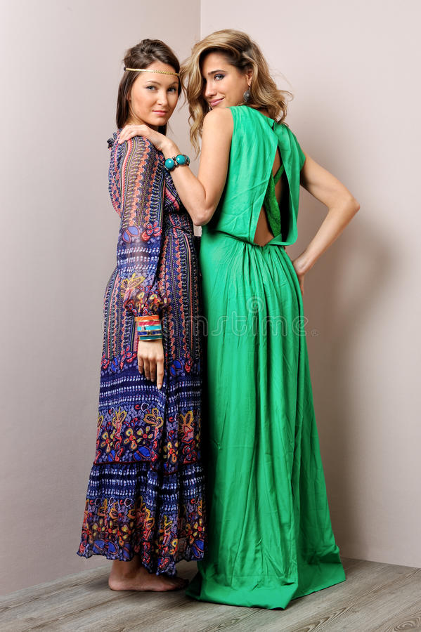 Two woman in long dresses. Two beautiful women in long dresses royalty free stock photos