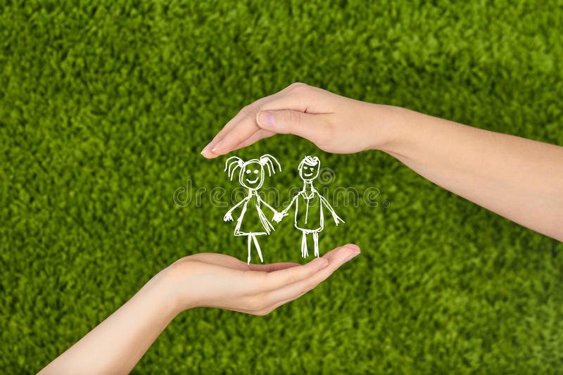Two Woman's open hands making a protection gesture. On green background.Family life insurance, protecting children stock image