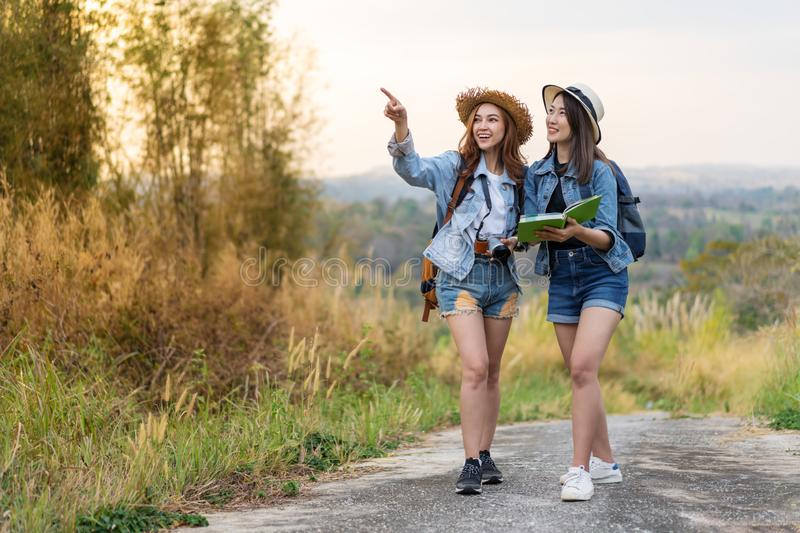 Two woman searching direction on location map while traveling. Two women traveler searching direction on location map while traveling royalty free stock images