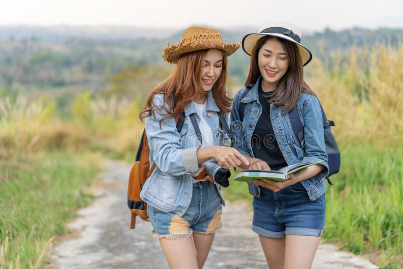 Two woman searching direction on location map while traveling. Two women traveler searching direction on location map while traveling royalty free stock photo