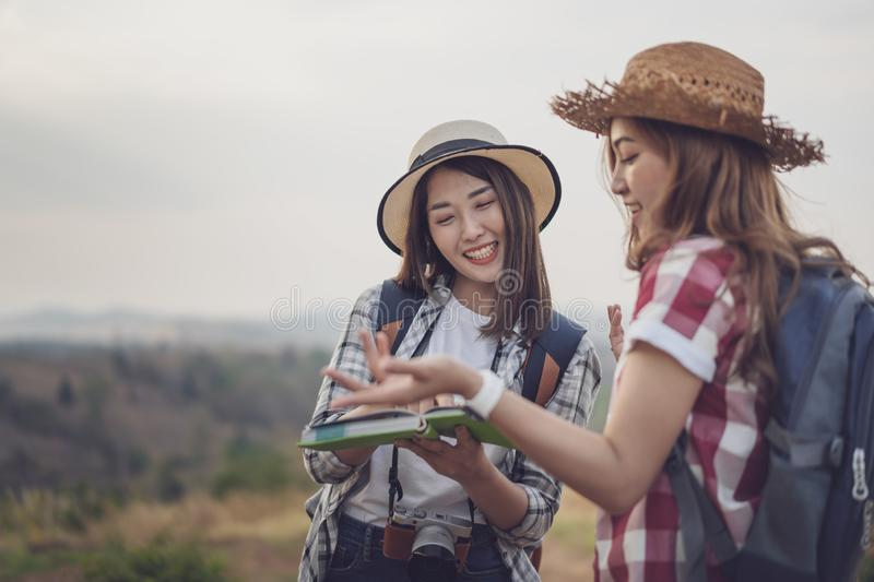 Two woman searching direction on location map while traveling. Two women traveler searching direction on location map while traveling stock image