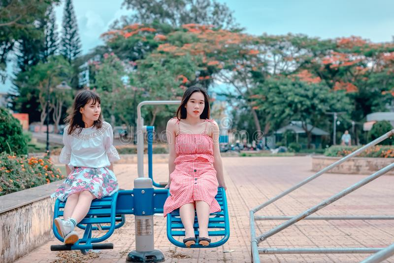 Two Woman Sitting at Park Ride royalty free stock photo