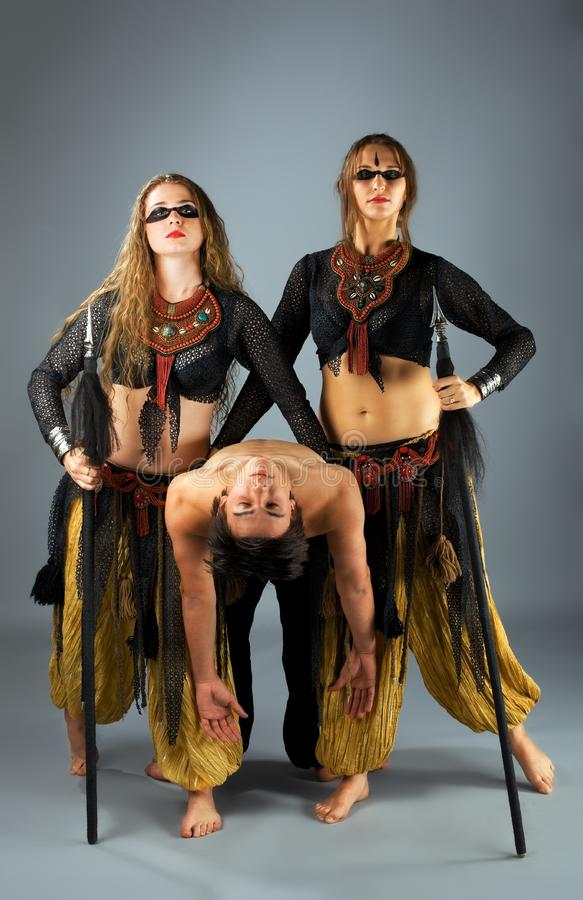 Two woman with spear and dead man royalty free stock image
