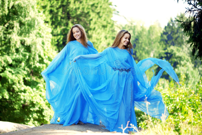 Download Two Woman, Twins In The Forest Stock Image - Image of freedom, free: 21940303