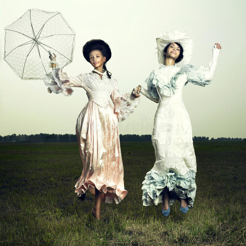 Two woman in vintage dress royalty free stock photos