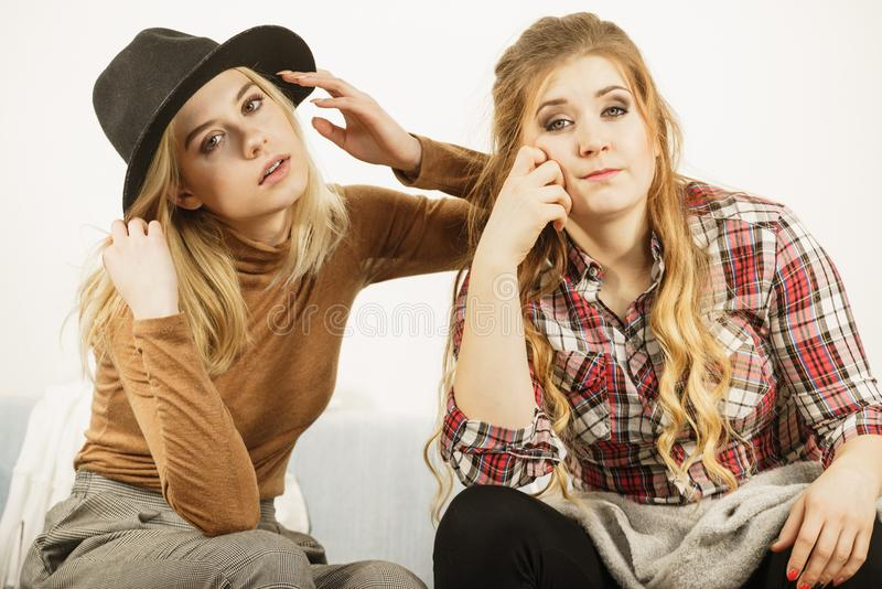 Two women being tired or bored royalty free stock photo