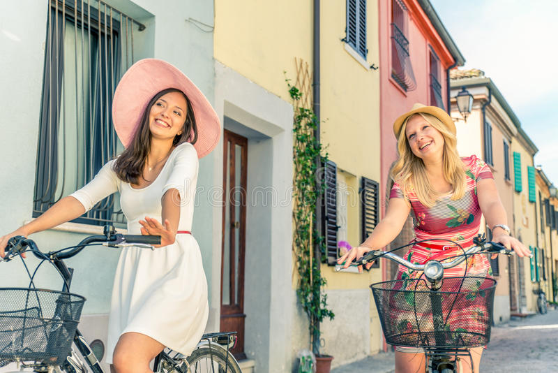 Two women on bicycles stock images