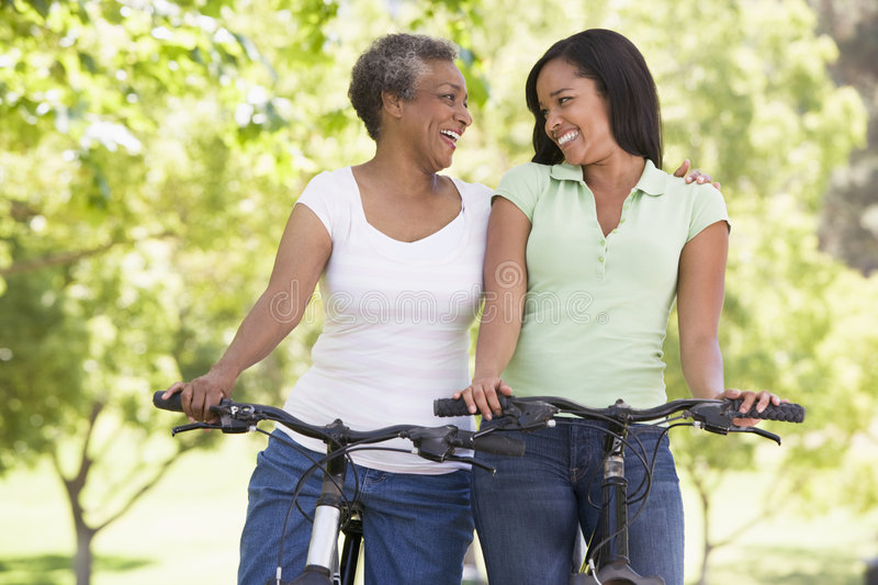 Download Two Women On Bikes Outdoors Smiling Stock Image - Image: 5772141