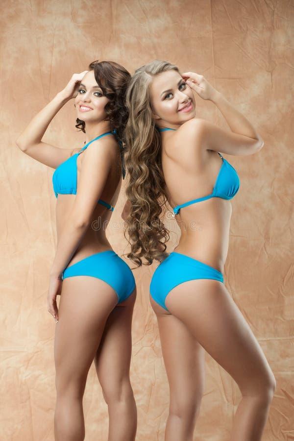 Two women in bikini royalty free stock photography