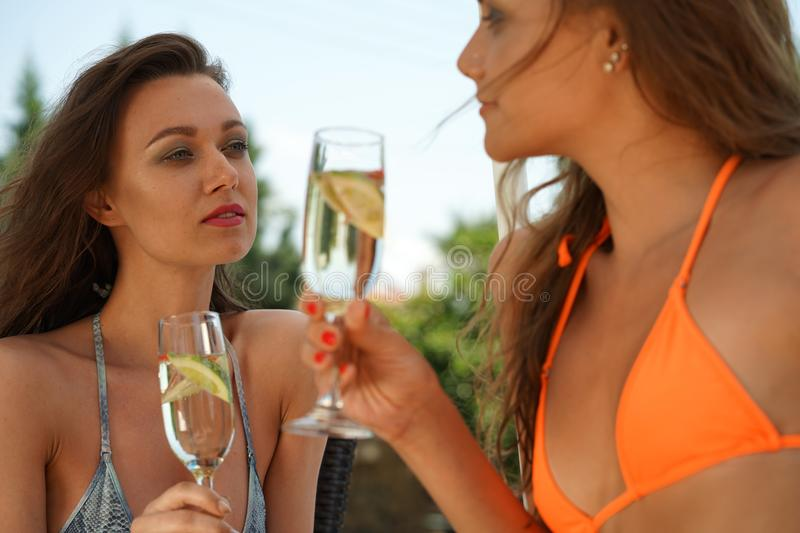 Two women drinking cocktails royalty free stock images