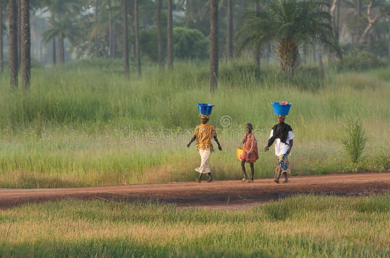 Two women and a boy in The Gambia