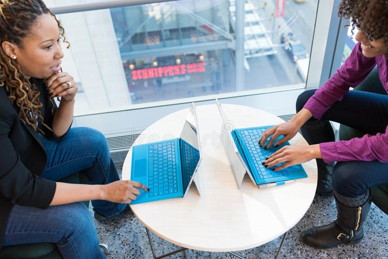 Two Women Browsing On Laptop Computers royalty free stock photos