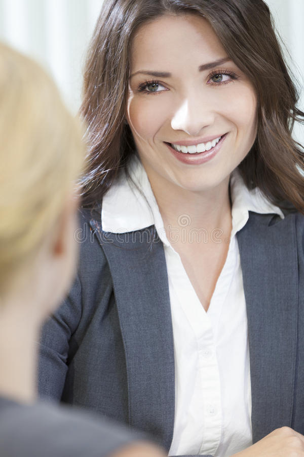 Download Two Women Or Businesswomen In Office Meeting Stock Photo - Image: 25649100