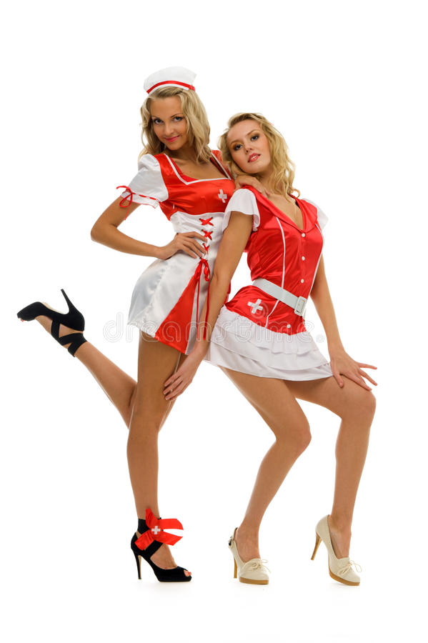 Two women in carnival costume. Nurse shape. Isolated image royalty free stock images