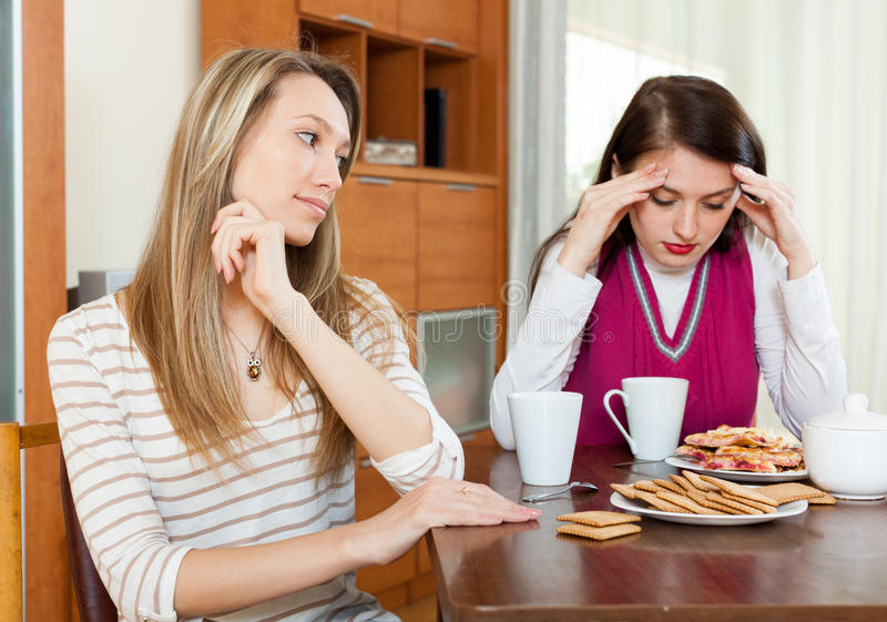Two women after conflict at table royalty free stock photo
