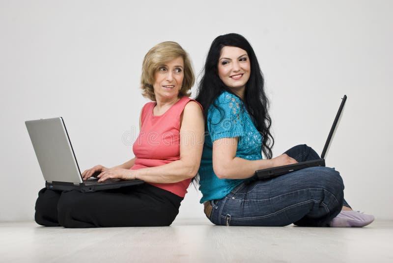 Two women conversation using laptop