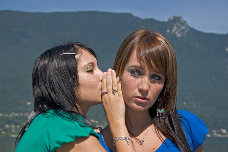 Two women discussing stock image