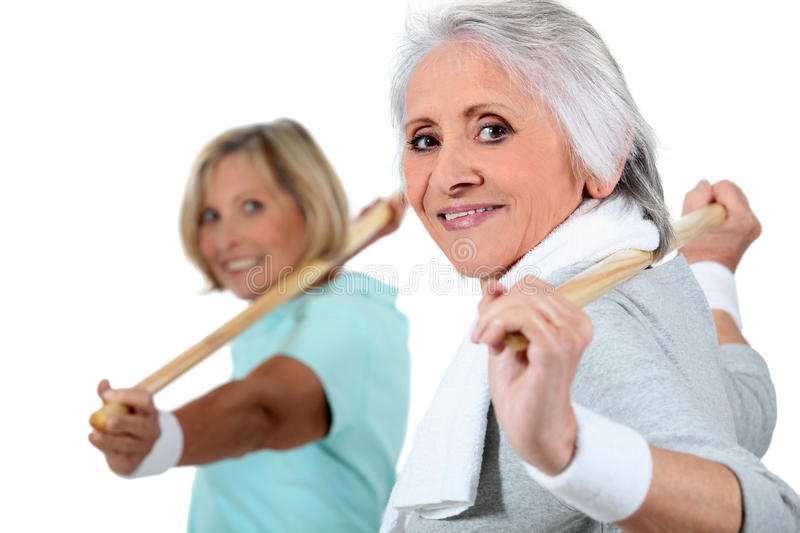 Two women doing exercise royalty free stock image