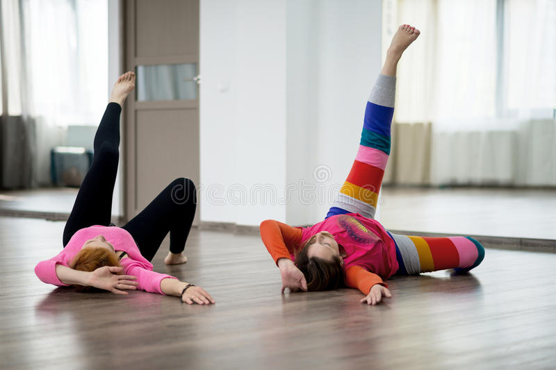 Two women doing physical practice stock image