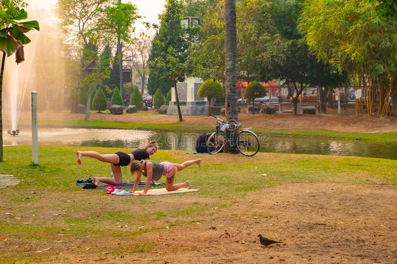 Two women doing streching exercise as same as Yoga royalty free stock photo