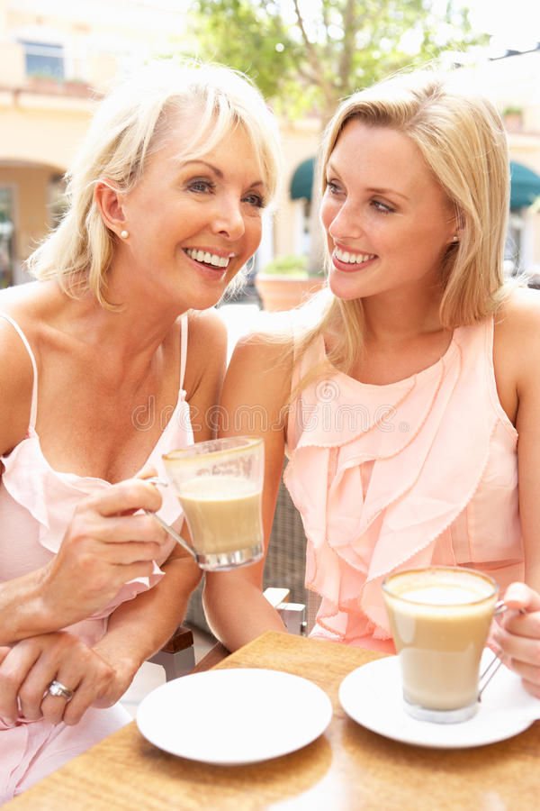 Two Women Enjoying Cup Of Coffee royalty free stock photography