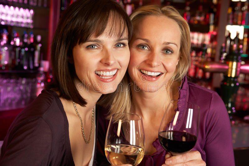 Download Two Women Enjoying Drink Together In Bar Stock Image - Image: 24385157
